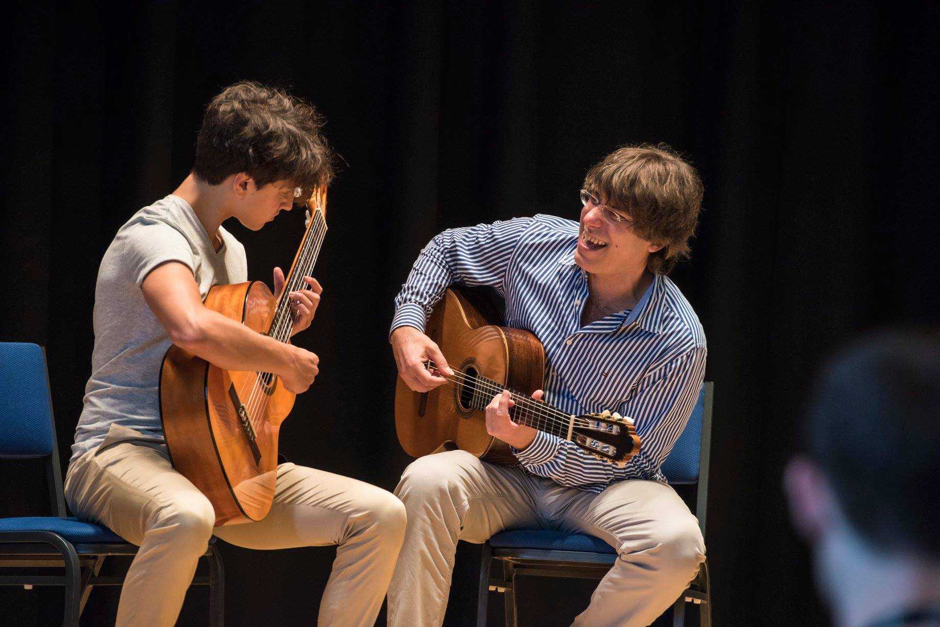 student and teacher on stage at guitarfest