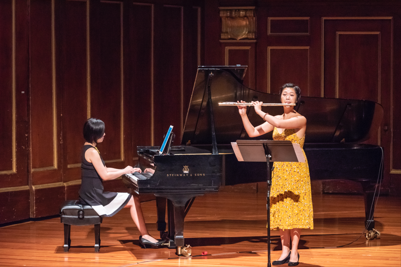 Feng Niu playing piano and Annie Wu playing flute