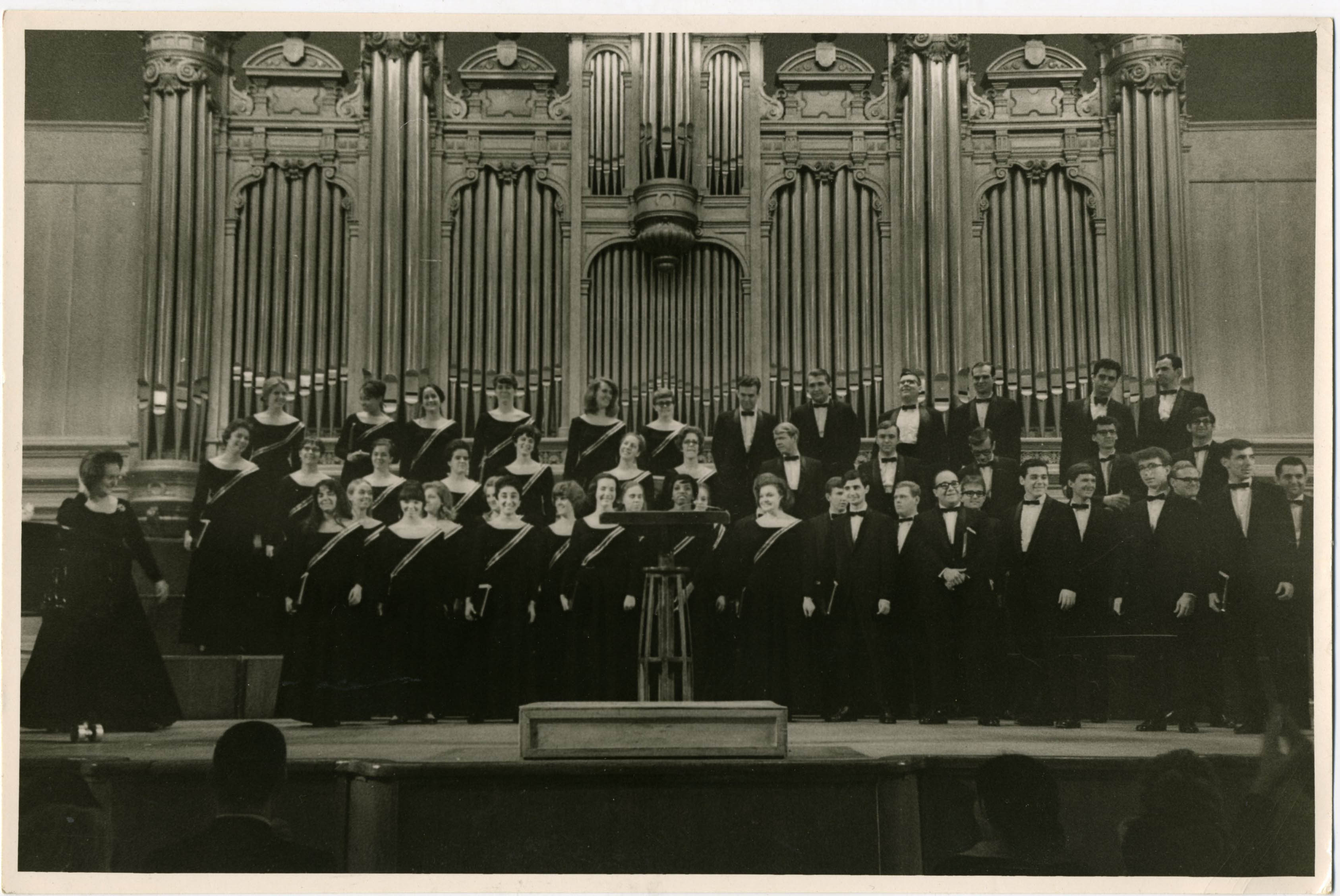 Lorna Cooke deVaron poses with the NEC Chorus in a concert hall in Moscow in 1966.