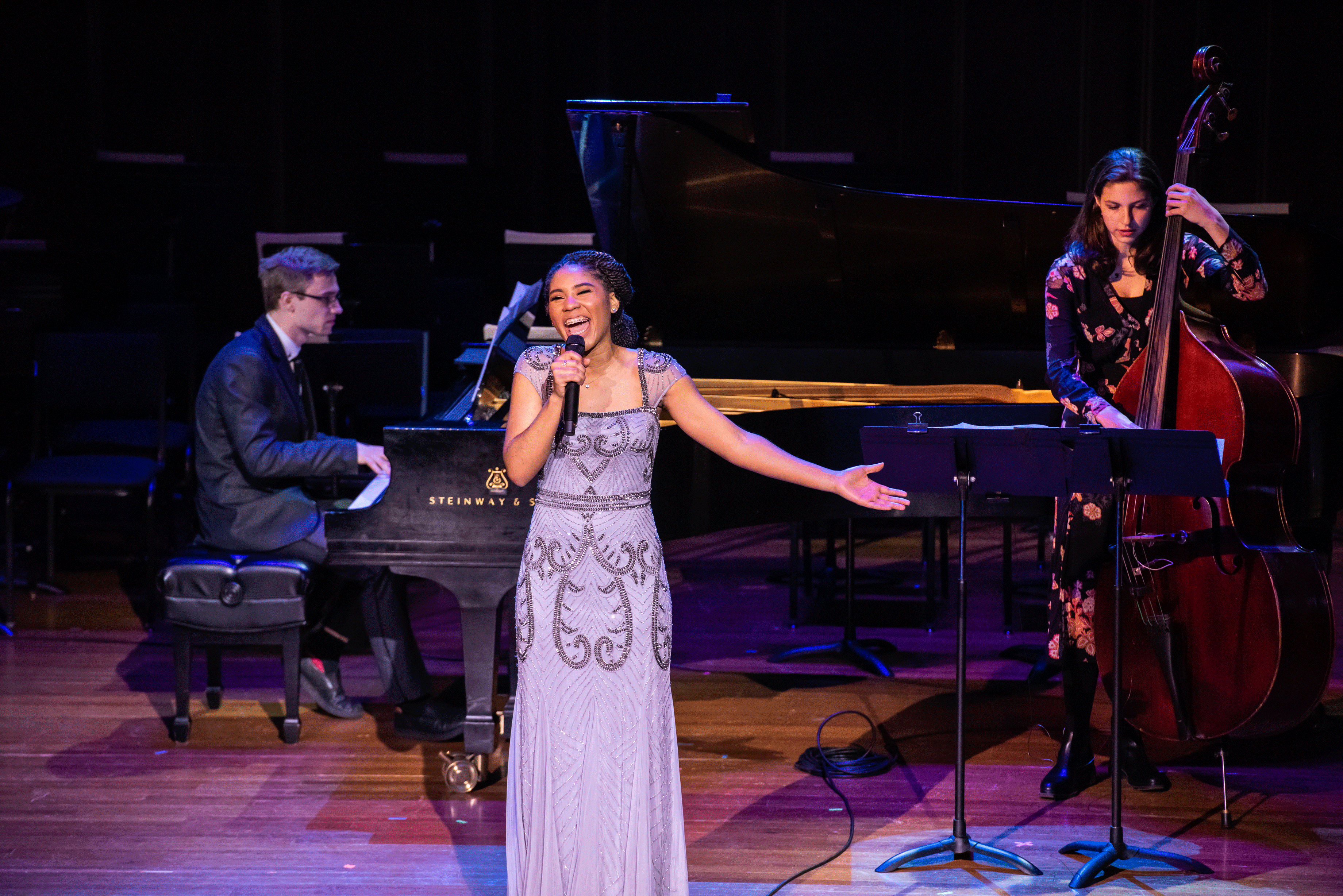 Darynn Dean sings with a pianist and bassist