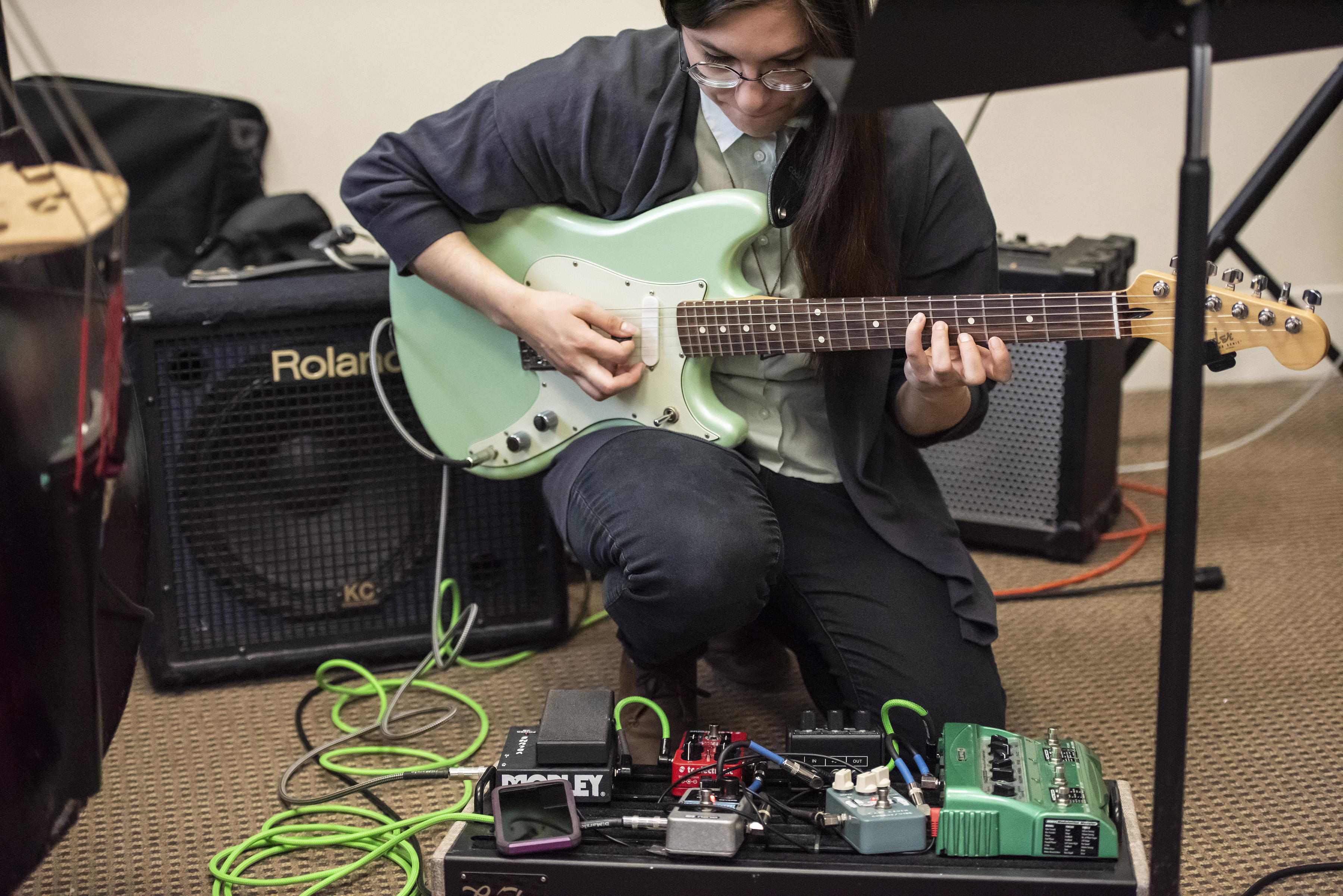 Magdalena Abrego playing her electric guitar