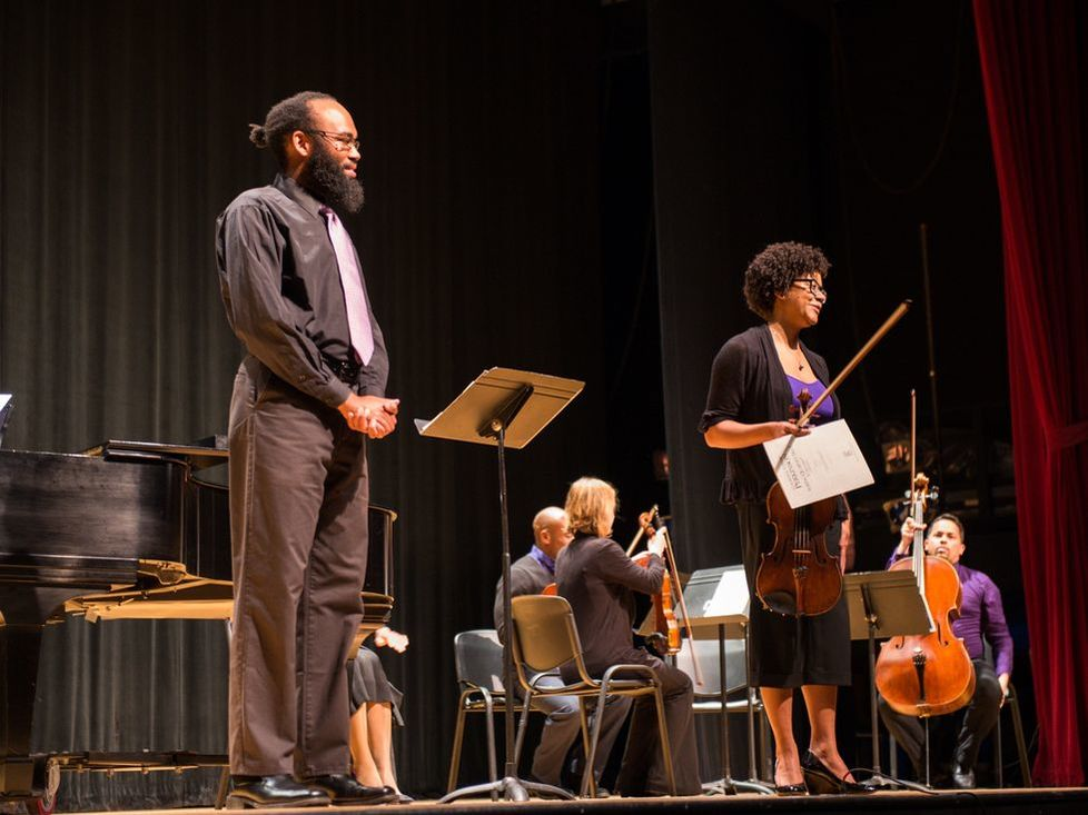 Anthony R. Green and Ashleigh Gordon on stage with a string quartet