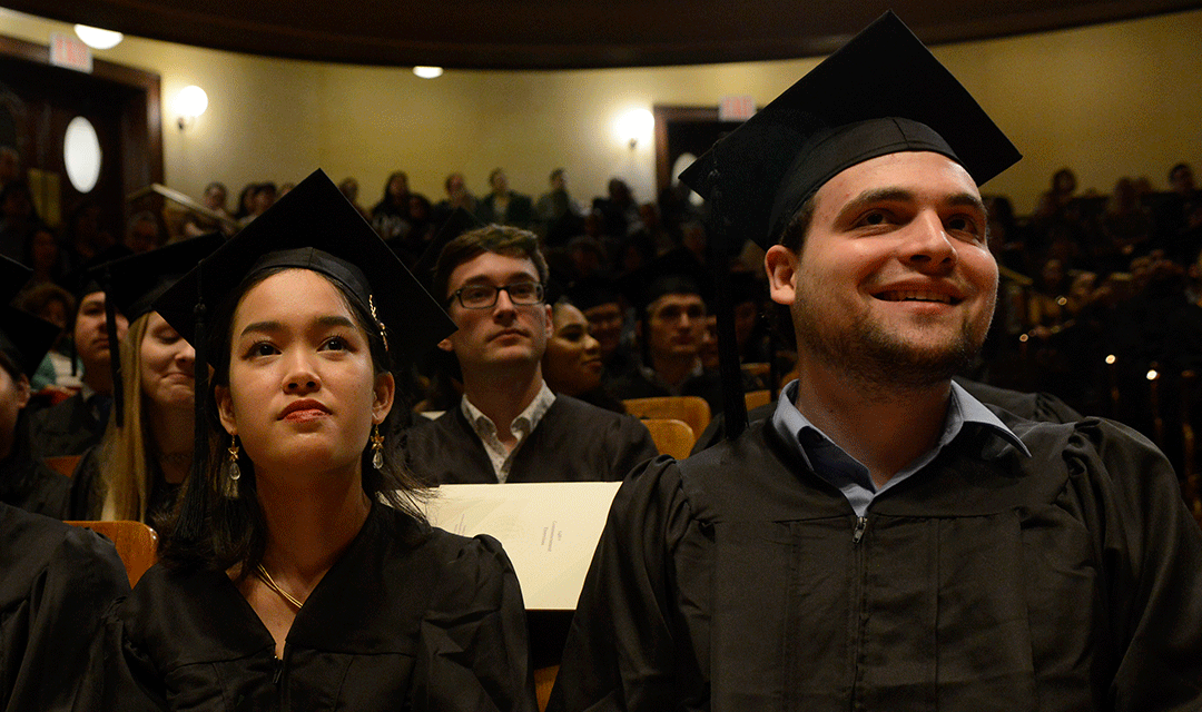 Graduates sit in Jordan Hall