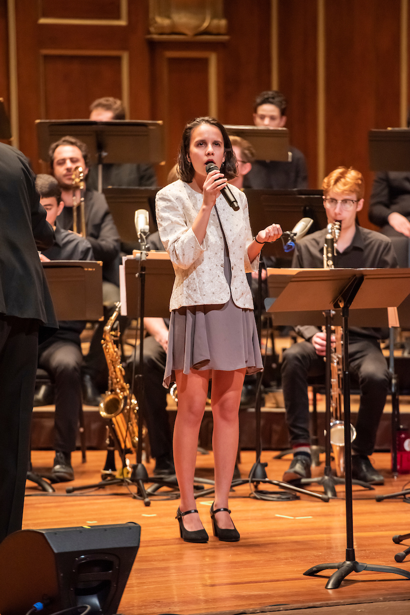 Priya Carlberg sings as a soloist with the NEC Jazz Orchestra behind her.