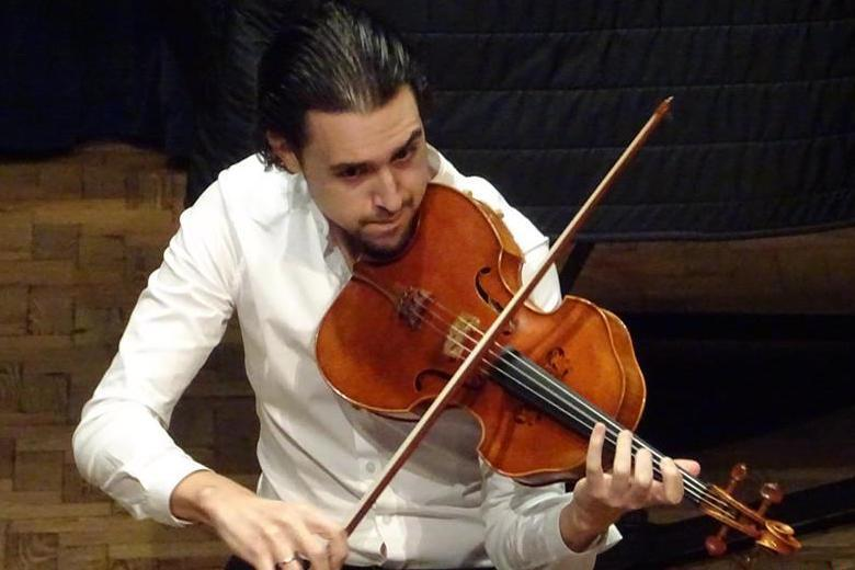 Paul Laraia plays viola in the Tertis competition.