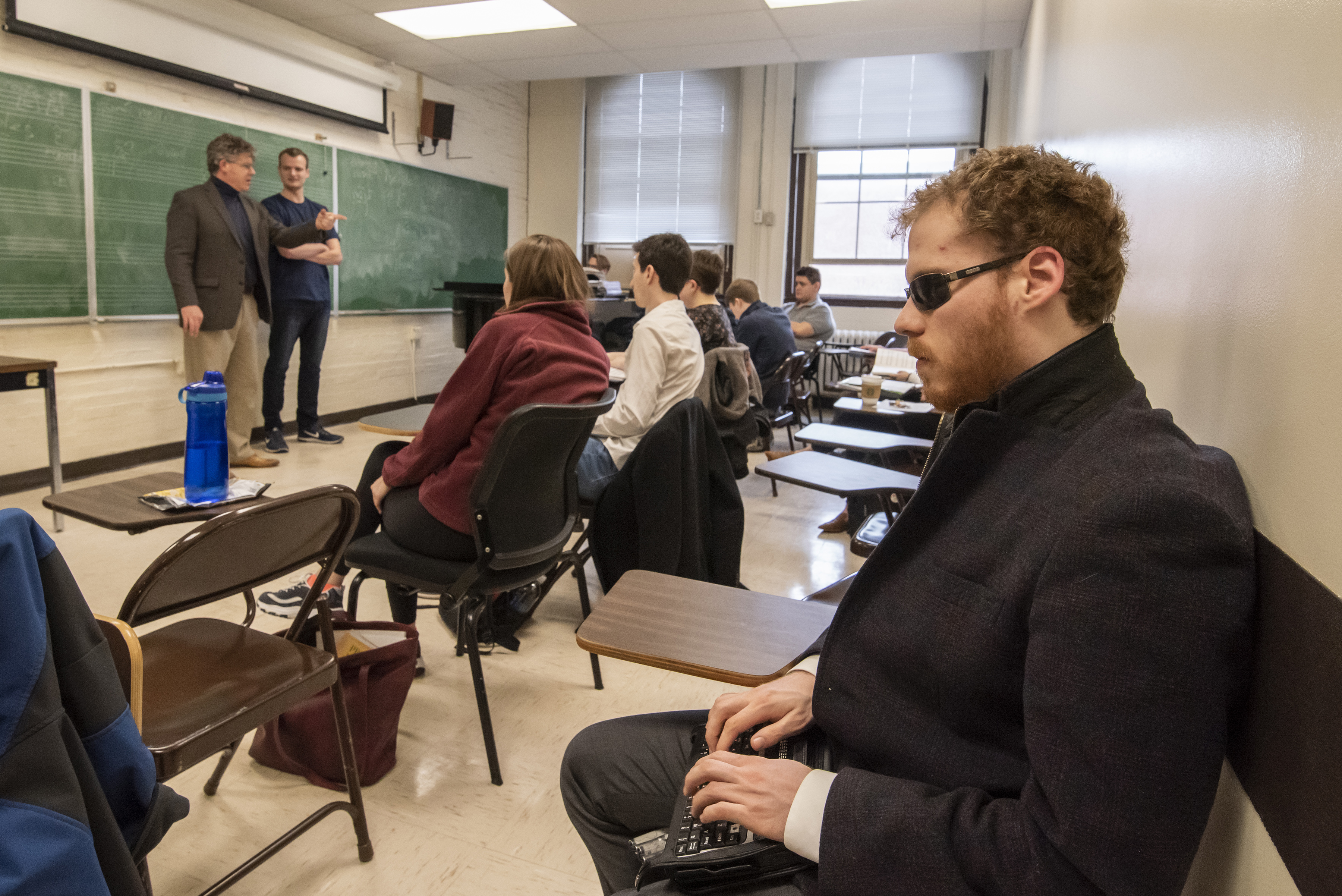 Matt Shifrin takes notes in Michael Meraw's Classical Singing Class