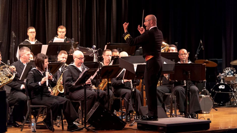 Joel Borrelli-Boudreau conducts the Navy Band Northeast