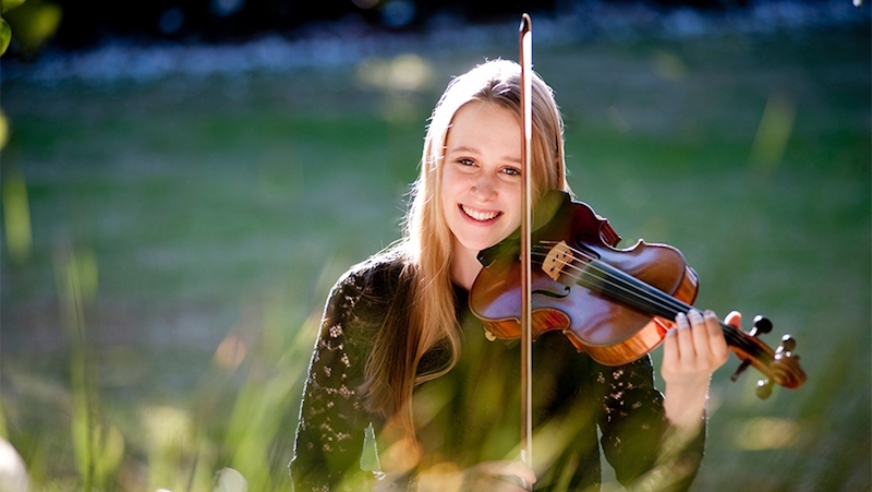 Grace Clifford smiles and plays the violin