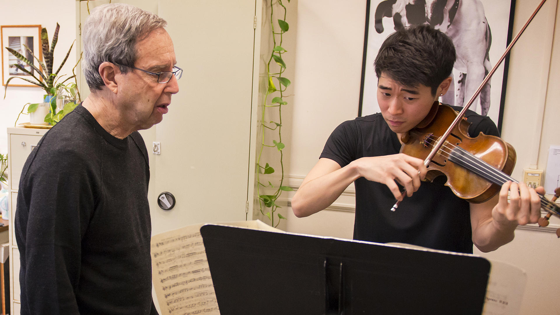 Donald Weilerstein teaches a violin lesson