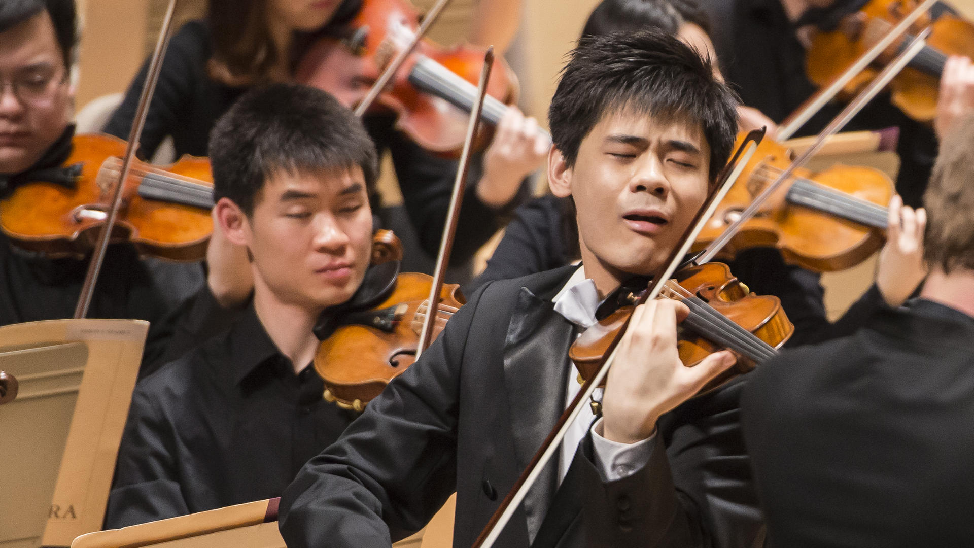 Angelo Yu performs with the NEC Philharmonia