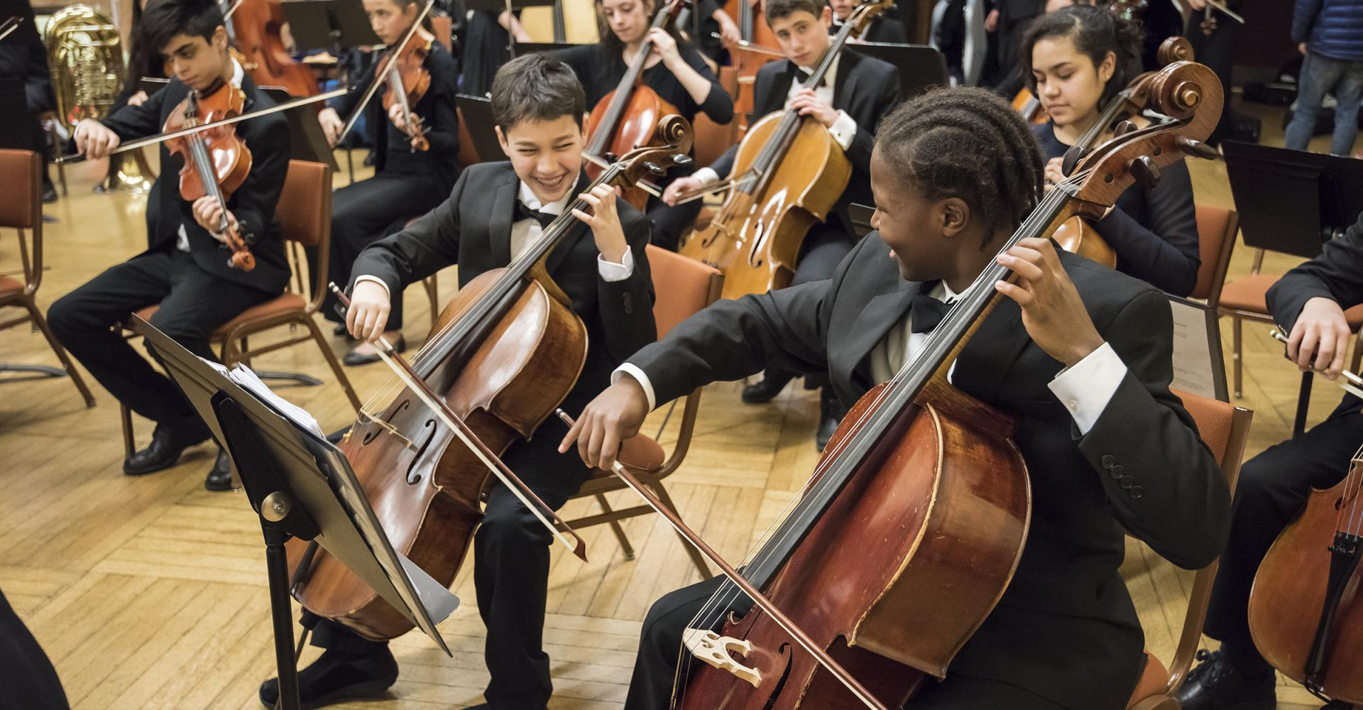 Prep Youth Symphony Cellists laughing