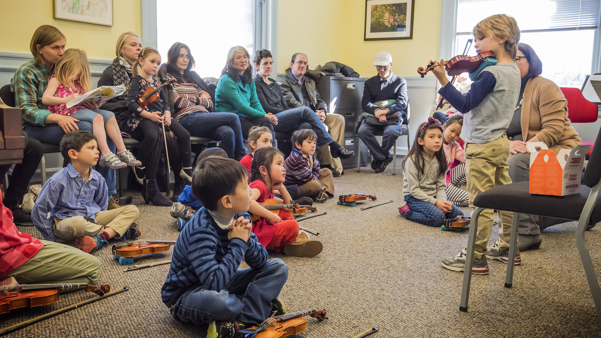 A Prep Suzuki violinist plays for his class
