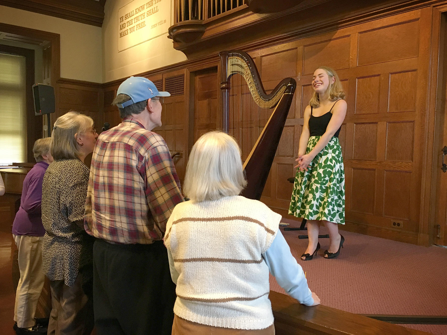 A C P P harpist smiles after a performance