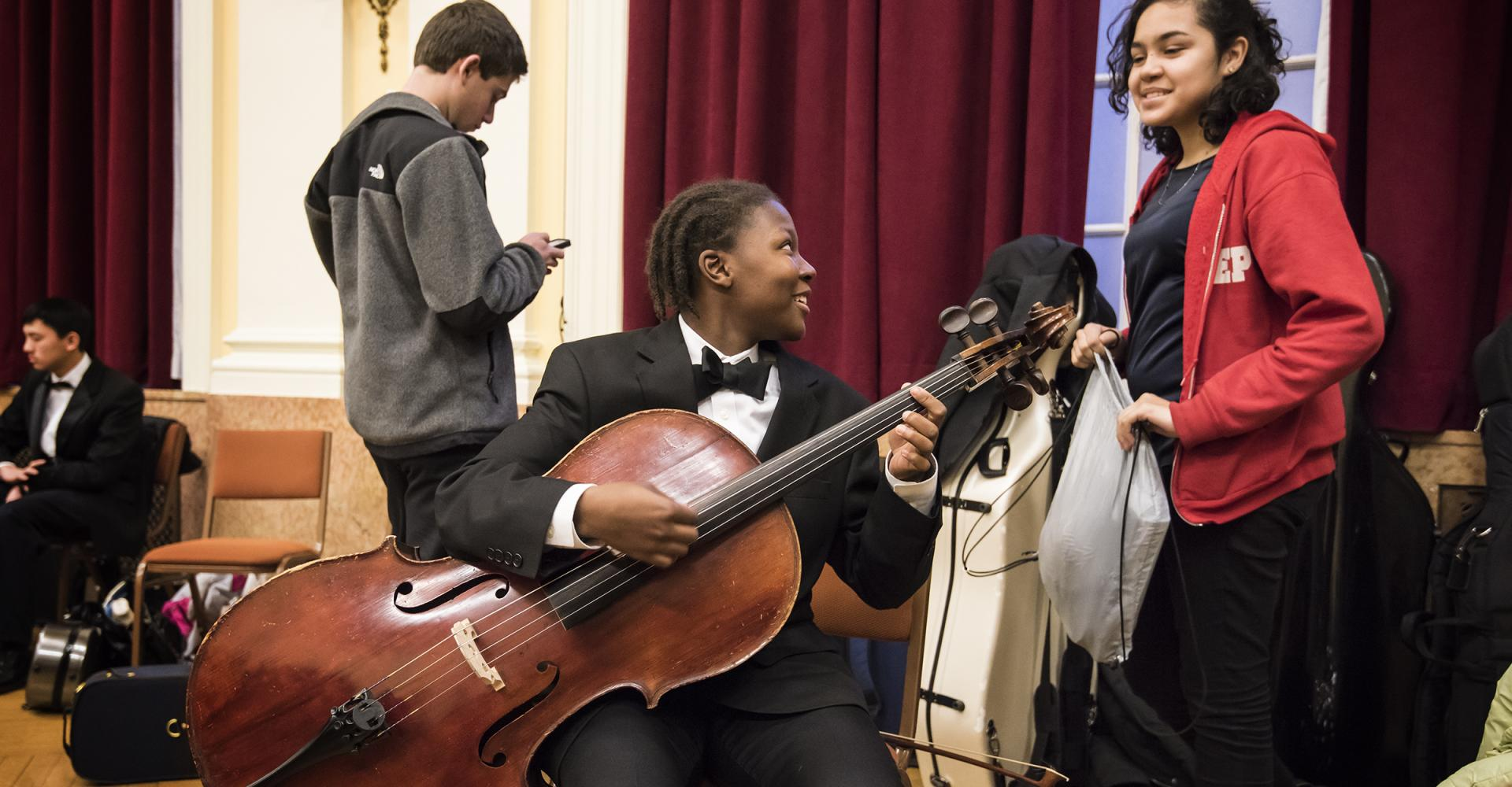 Cellists having fun before a concert