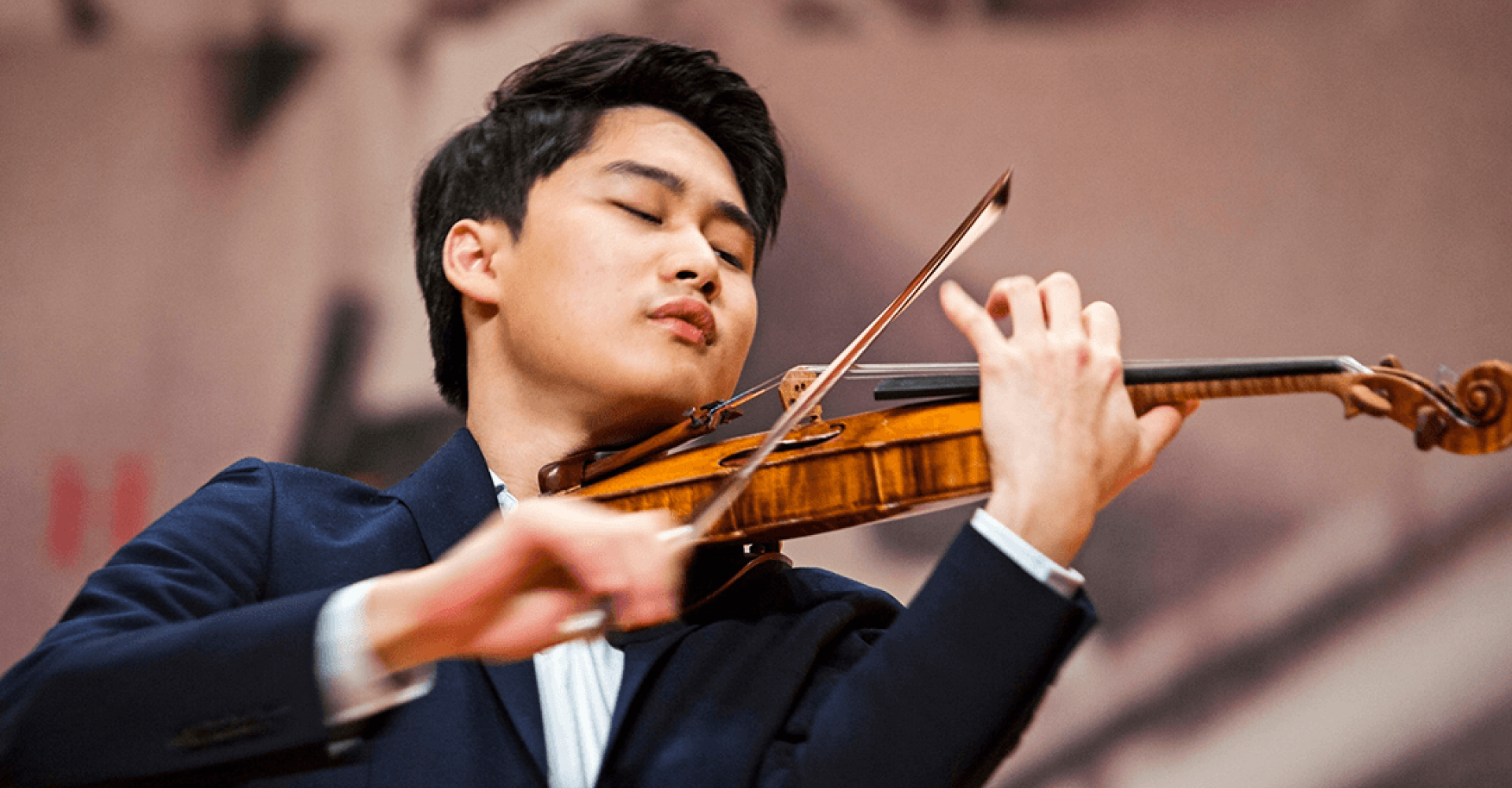 Artist Diploma student Inmo Yang plays the violin with his eyes closed.