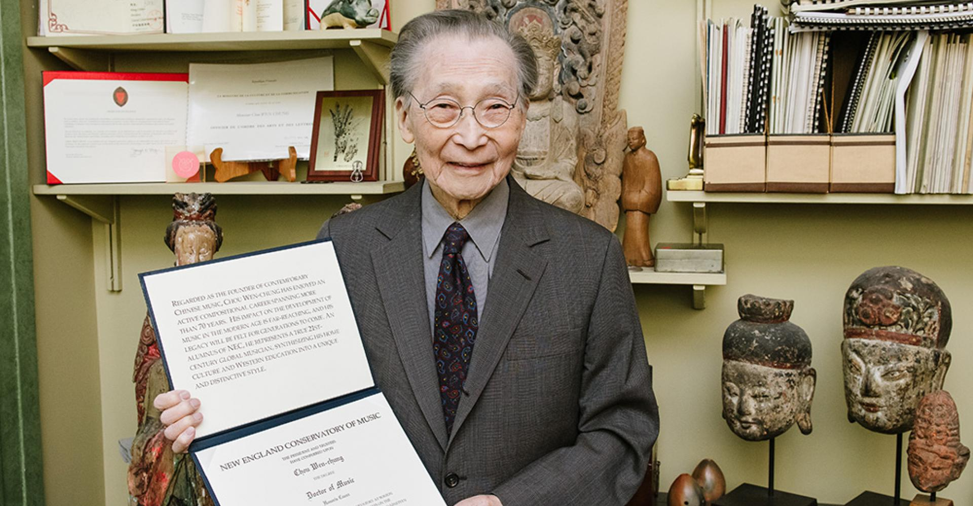 Chou Wen-chung holding his honorary degree