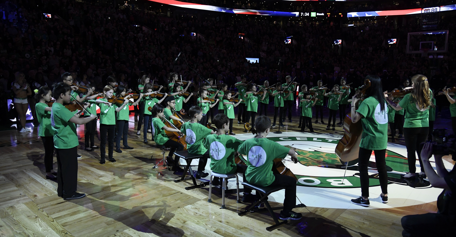 Children in NEC's Suzuki Prep program play at the Celtics stadium