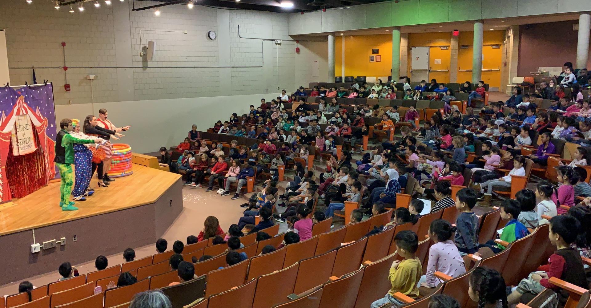 Touring Children's Opera cast performing for a full house.