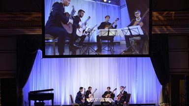 A classical guitar quartet performs