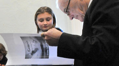 Peter Maxwell Davies looks over a student composition