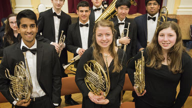 A Prep brass section before a concert
