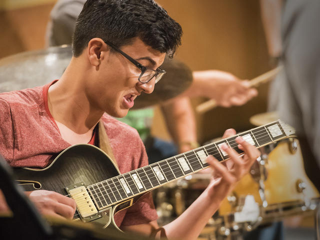 A guitarist from NEC Jazz Studies performs