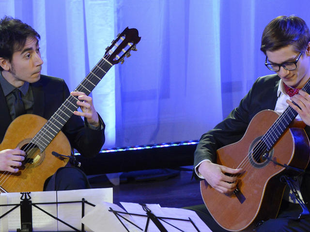 Two classical guitarists perform