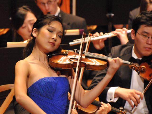 Grace Park playing violin with NEC Phil