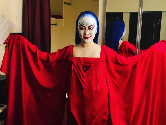 Soprano So Young Park models her Queen of the Night costume backstage during The Magic Flute at the Met