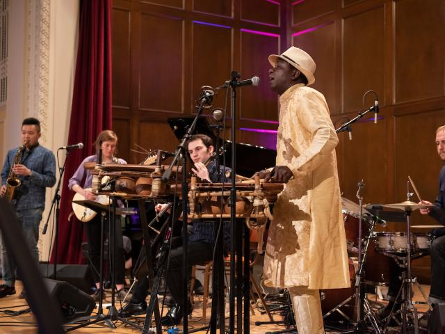 Balla Kouyate plays the balafon and sings while leading students in the West African Ensemble