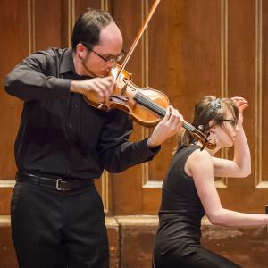 Violinist and pianist perform together