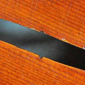 Close-up of violin f-hole