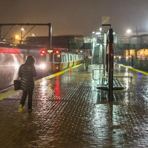 A scenic view of Boston's Mass Ave T stop in the rain