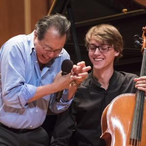 Yo-Yo Ma works with a student cellist during a masterclass