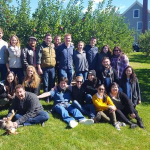 The Chamber Singers relax in an apple orchard