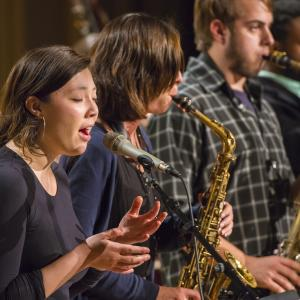 A singer performs as part of a jazz ensemble