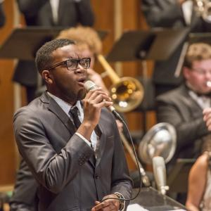 A jazz vocalist performs with the N E C Jazz Orchestra
