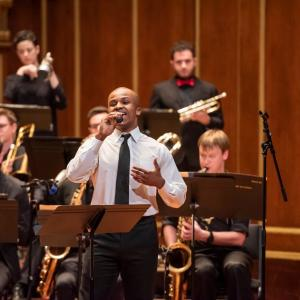 A singer performs with the NEC Jazz Orchestra